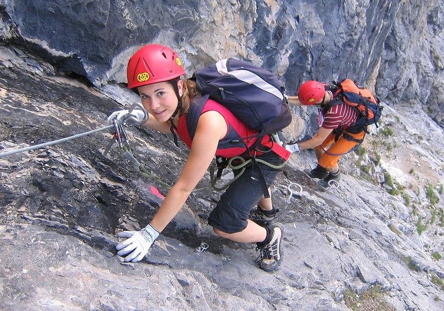 Medium 1200px climber on fixed rope route piz mitgel 2